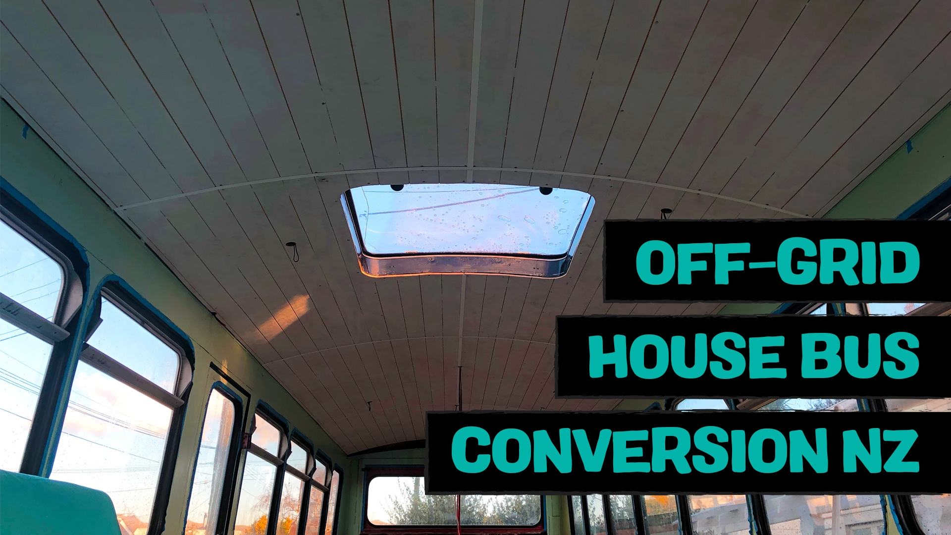 Skylight repair, ceiling installation, interior walls and vintage belted sofa